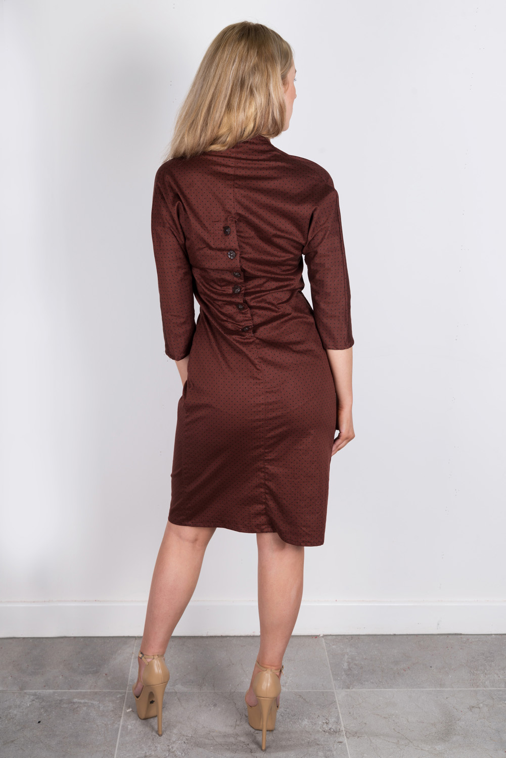 Wiggle dress with gathered bra piece, high waist, dolman sleeve and shaped collar line. Button back